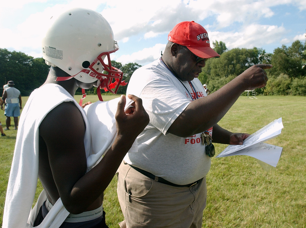. Pontiac Northern High School football head coach Keith Stephens, right, calls a play for the special teams unit to run during practice, Tuesday, August 8, 2006, at Northern HS in Pontiac, Mich.  (The Oakland Press/Jose Juarez)