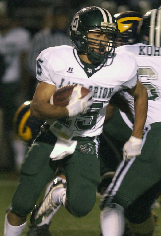 . Lake Orion High School football player Daniel Ney runs for yardage against Clarkston High School during first quarter action.  Photo taken on Friday, October 30, 2009, in Clarkston, Mich.  (The Oakland Press/Jose Juarez)