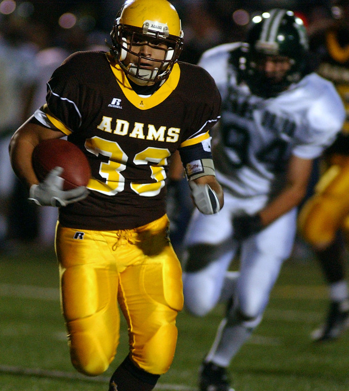 . Rochester Adams High School football running back Beau Barterian runs away from the Lake Orion defense and scores a touchdown, during second quarter action, Friday, October 17, 2008, in a game played at Rochester Adams HS in Rochester Hills, Mich.  (The Oakland Press/Jose Juarez)