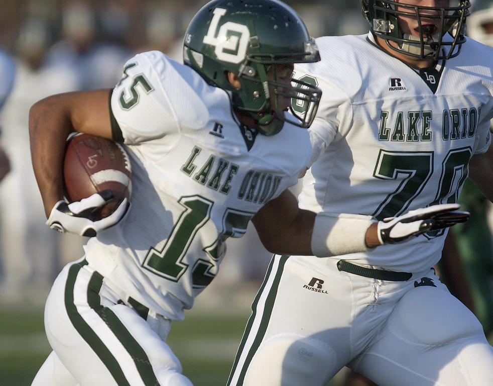 . Lake Orion High School football player Daniel Ney scores a touchdown on this run against West Bloomfield, during first quarter action, Thursday, September 3, 2009, in a game played at West Bloomfield HS in West Bloomfield, Mich.  (The Oakland Press/Jose Juarez)