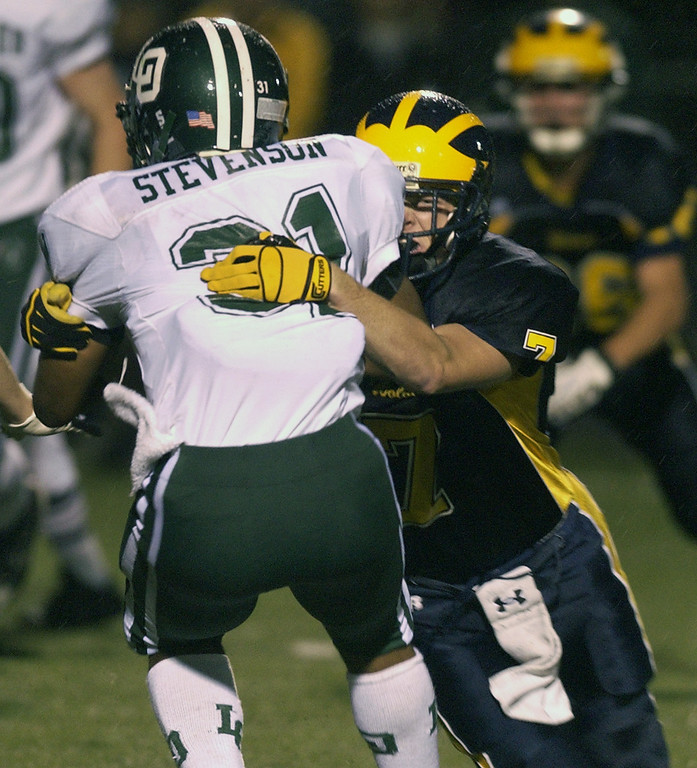. Clarkston High School football player Chris Canada, right, puts a hard tackle on Lake Orion player Marques Stevenson during second quarter action.  Photo taken on Friday, October 30, 2009, in Clarkston, Mich.  (The Oakland Press/Jose Juarez)