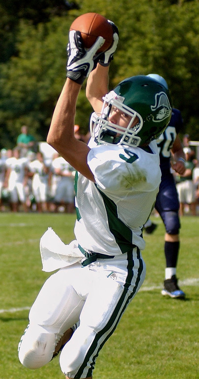 . Waterford Kettering High School football player Paul Fry hauls in a pass and runs in for a touchdown during second quarter action, Saturday, September 20, 2008, in a game played at Mott HS in Waterford, Mich.  (The Oakland Press/Jose Juarez)