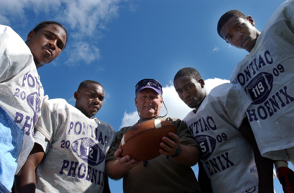 . (from left) Pontiac High School football players Andre Foster, Jabari Martin head coach Greg Garfield, Reggie Washington and Dominique Shaw.