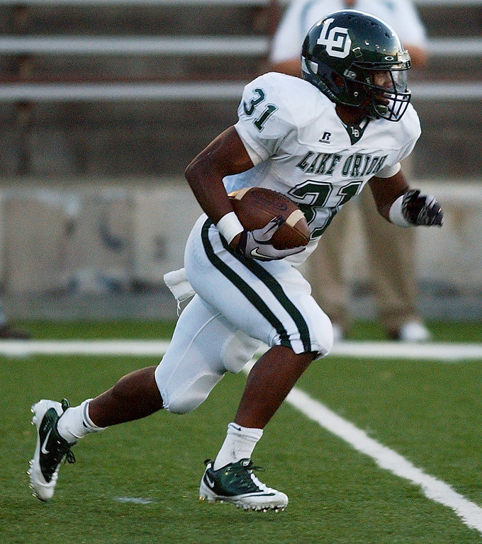 . Lake Orion High School football player Marques Stevenson runs for yardage against Pontiac during second quarter action.  Photo taken on Friday, September 10, 2010, in a game played at Wisner Stadium in Pontiac, Mich.  (The Oakland Press/Jose Juarez)