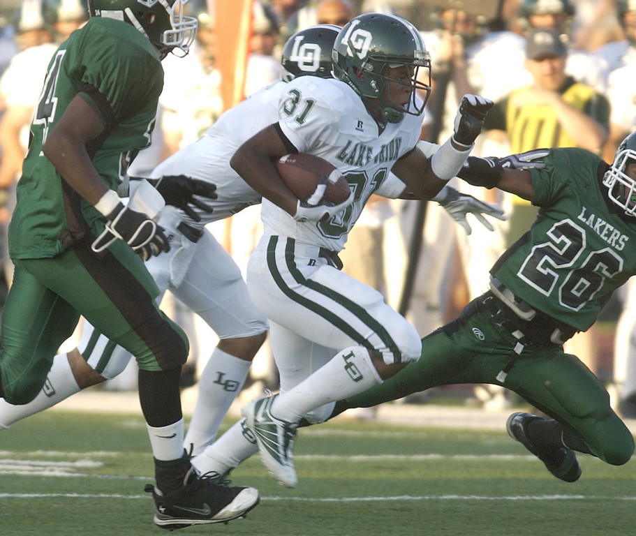 . Lake Orion High School football player Marques Stevenson (#31) rushes for yardage against West Bloomfield, during first quarter action, Thursday, September 3, 2009, in a game played at West Bloomfield HS in West Bloomfield, Mich.  (The Oakland Press/Jose Juarez)