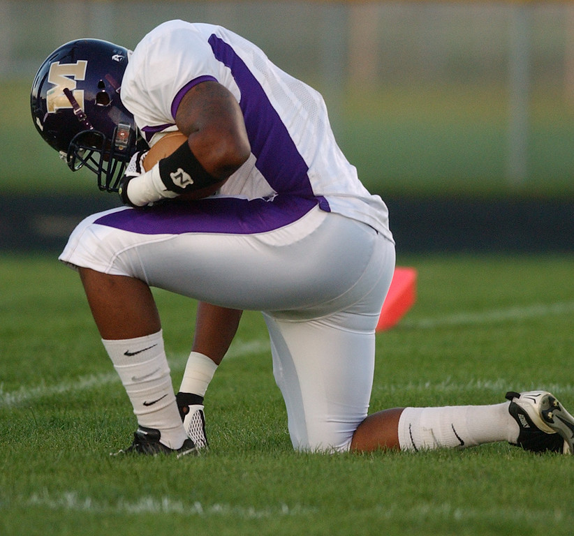 . Madison Heights Madison High School football player DeVonte Snyder prays in the endzone after catching a touchdown pass against Madison Heights Lamphere during first quarter action.  Photo taken on Friday, September 24, 2010, in a game played at Lamphere HS in Madison Heights, Mich.  (The Oakland Press/Jose Juarez)