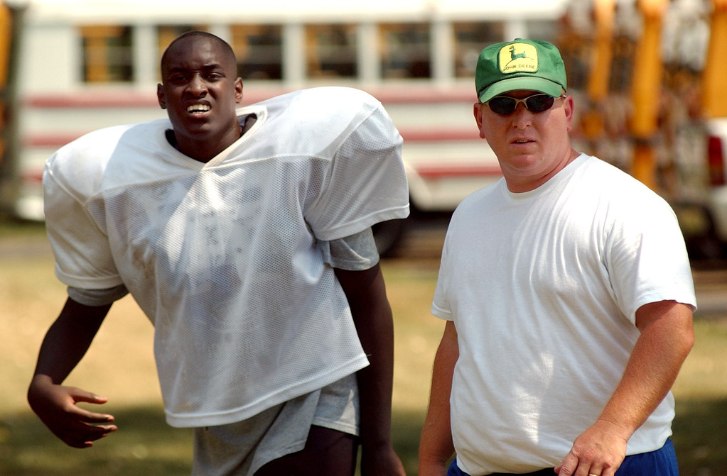. Southfield Christian High School football head coach Tim Fracassi, right, walks with one of his players during a break in practice.  Photo taken on Monday, August 18, 2008, in Southfield, Mich.  (The Oakland Press/Jose Juarez)