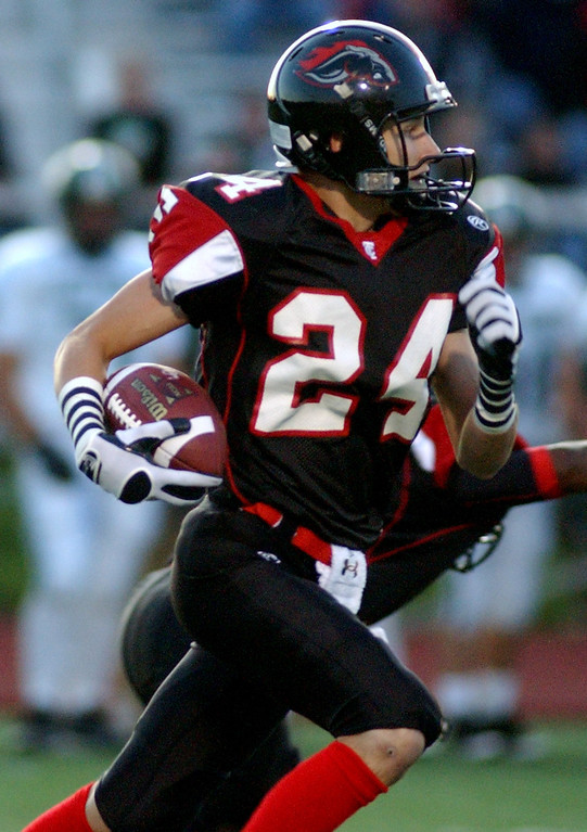 . Troy High School football player Robert Pardun runs for yardage against Lake Orion during first quarter action, Friday, October 3, 2008, at Troy HS in Troy, Mich.  (The Oakland Press/Jose Juarez)