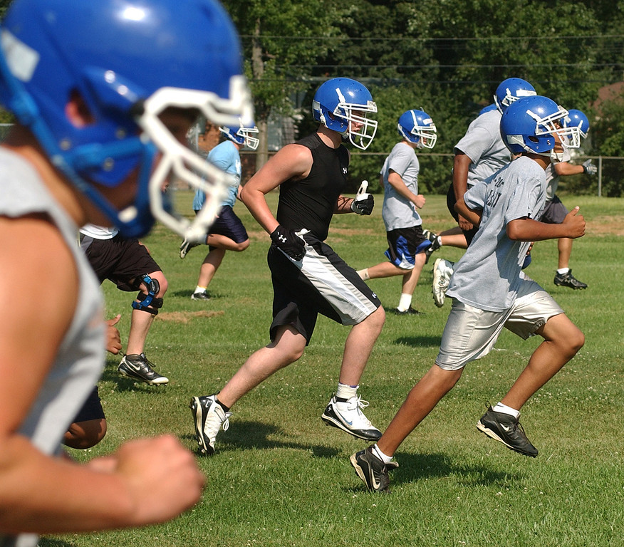 . Southfield Christian High School football squad members warm up before the start of practice.  Photo taken on Tuesday, August 10, 2010, at Southfield Christian HS in Southfield, Mich.  (The Oakland Press/Jose Juarez)