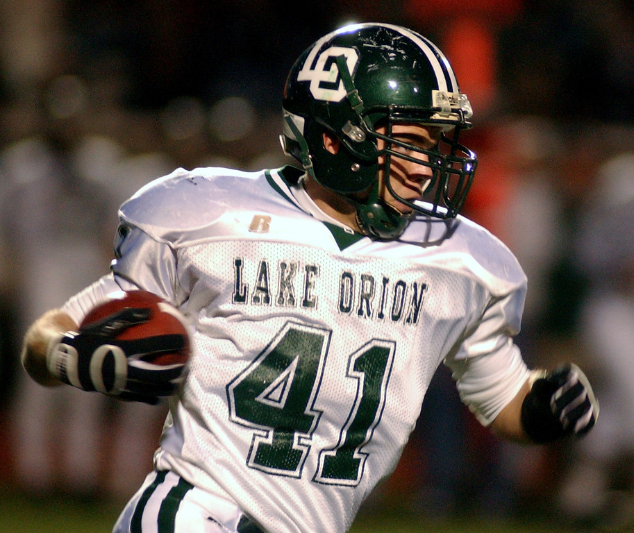 . Lake Orion High School football player Eric Knoblock runs for yardage against Troy during second quarter action, Friday, October 3, 2008, at Troy HS in Troy, Mich.  (The Oakland Press/Jose Juarez)