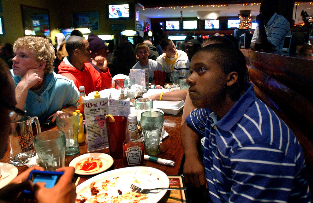 . Tevin Gripper, right, who is a sophomore football player at West Bloomfield High School, watches a Michigan high school football pairings show with his teammates at The Lodge, Sunday, October 26, 2008, in Keego Harbor, Mich.  (The Oakland Press/Jose Juarez)