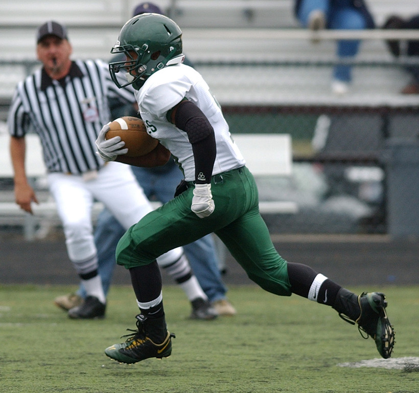 . Birmingham Groves High School football player Keon Collier runs for yardage against Berkley during first quarter action.  Photo taken on Saturday, September 11, 2010, in a game played at Hurley Field in Berkley, Mich.  (The Oakland Press/Jose Juarez)