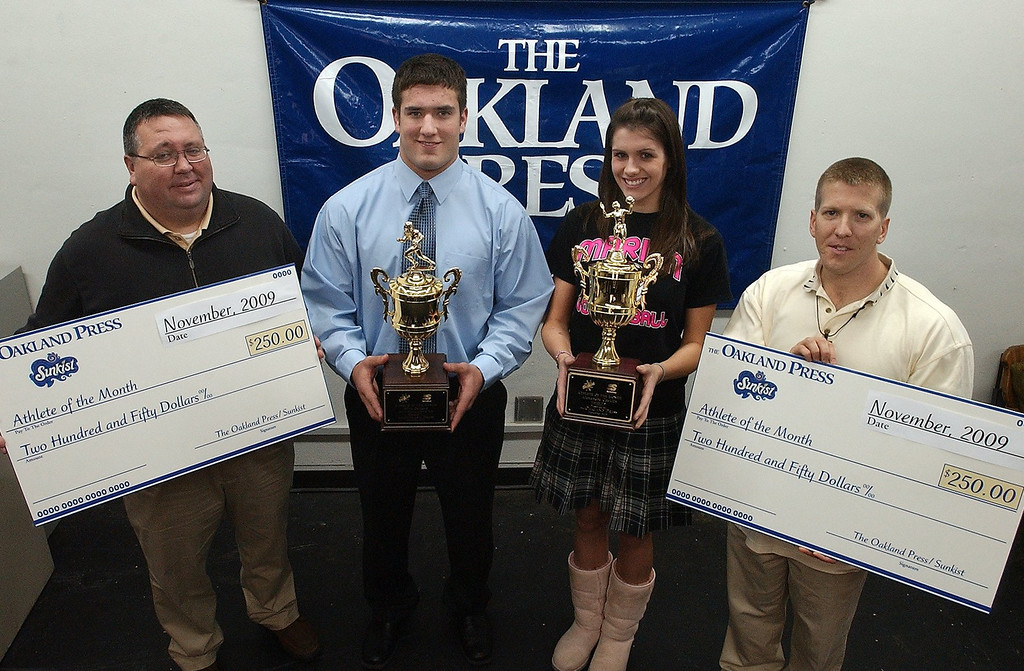 . (from left) Mark Flynn, district manager 7-Up of Detroit, with athletes of the month Niko Palazeti, Novi Detroit Catholic Central High School football, Alexandra Cocklin, Birmingham Marian High School volleyball and Keith Dunlap, Oakland Press sports reporter.