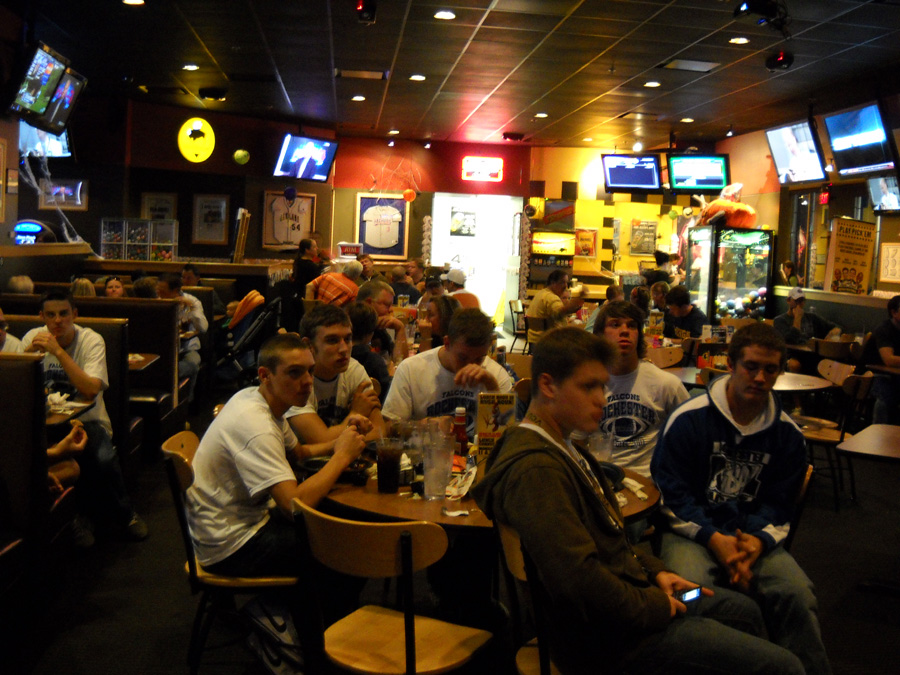 Description of . Members of the 2010 Rochester High School football team gathered at Buffalo Wild Wings to watch the MHSAA selection show on Sunday, Oct. 24, 2010. The Falcons earned a playoff berth for the fourth time, and the first time since 1999.