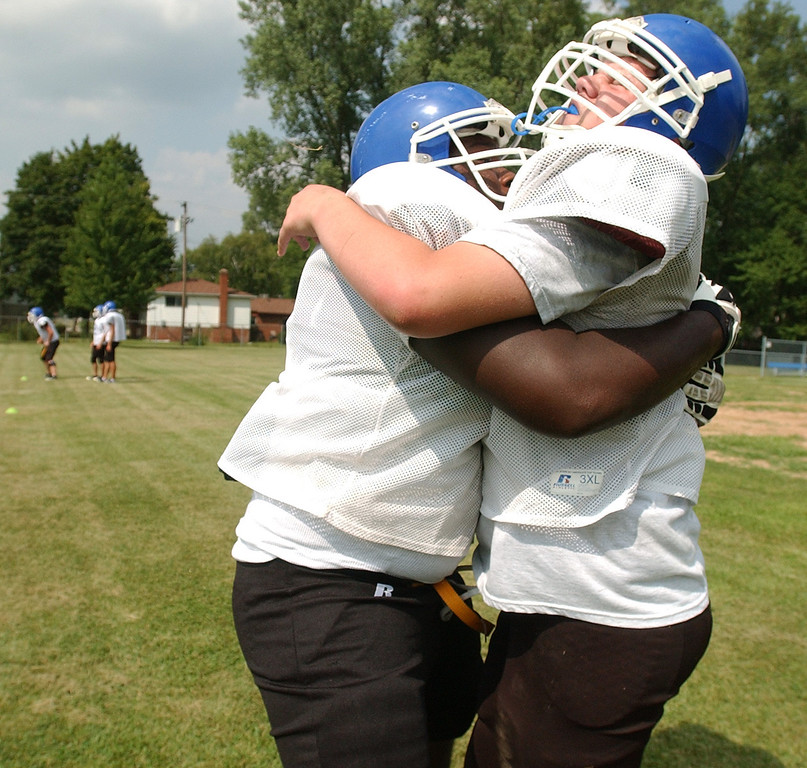 . Southfield Christian High School football player Shafer Johnson, who is a defensive tackle, tackles teammate Sam Dresser during practice.  Photo taken on Thursday, August 12, 2010, at Southfield Christian HS in Southfield, Mich.  (The Oakland Press/Jose Juarez)