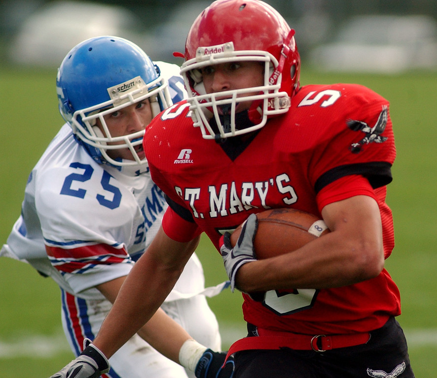 . Orchard Lake St. Mary\'s High School football player Sam Fioroni, front, runs for yardage as he is chased by Catholic Central defender John Jakubik during first quarter action, Saturday, October 4, 2008, at OLSM HS in Orchard Lake, Mich.  (The Oakand Press/Jose Juarez)