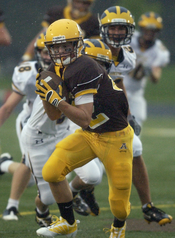 . Rochester Adams High School football player Alec Prechtel hauls in a pass for a first down against Clarkston during first quarter action, Friday, August 28, 2009, in Rochester Hills, Mich.  (The Oakland Press/Jose Juarez)