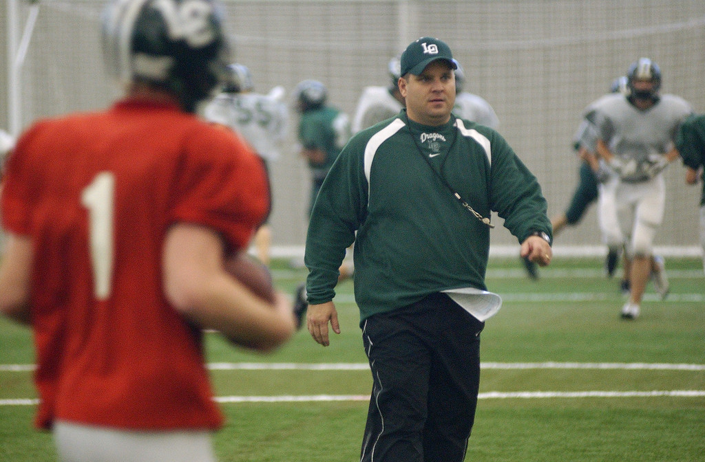 . Lake Orion High School football head coach Chris Bell watches his team practice, held inside Ultimate Soccer Arena.  Photo taken on Tuesday, November 25, 2008, in Pontiac, Mich.  (The Oakland Press/Jose Juarez)