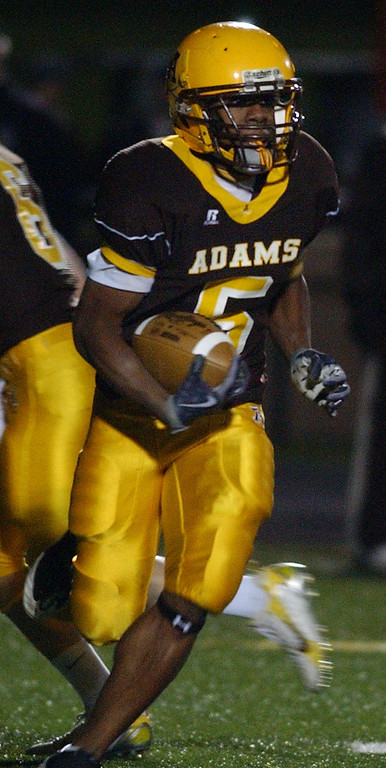 . Rochester Adams High School football player Darrian Bell rushes for yardage against Birmingham Brother Rice, during first quarter action.  Photo taken on Friday, November 6, 2009, in a game played at Rochester Adams HS in Rochester Hills, Mich.  (The Oakland Press/Jose Juarez)
