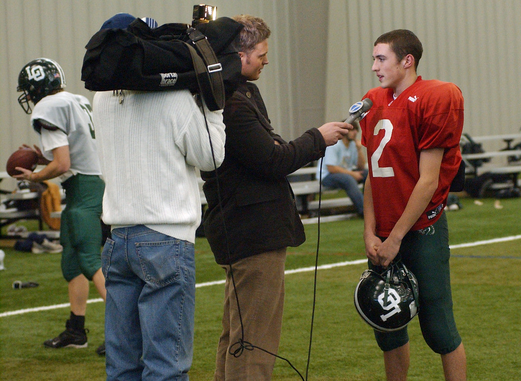 . Lake Orion High School football quarterback Sean Charette is interviewed by a local tv station before the start of practice.  Photo taken on Tuesday, November 25, 2008, in Pontiac, Mich.  (The Oakland Press/Jose Juarez)