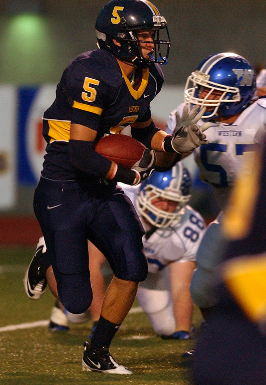 . Walled Lake Central High School football player Chris Koziara rushes for yardage during first quarter action against Walled Lake Western.  Photo taken on Friday, October 8, 2010, in a game played at Walled Lake Central HS in Walled Lake, Mich.  (The Oakland Press/Jose Juarez)