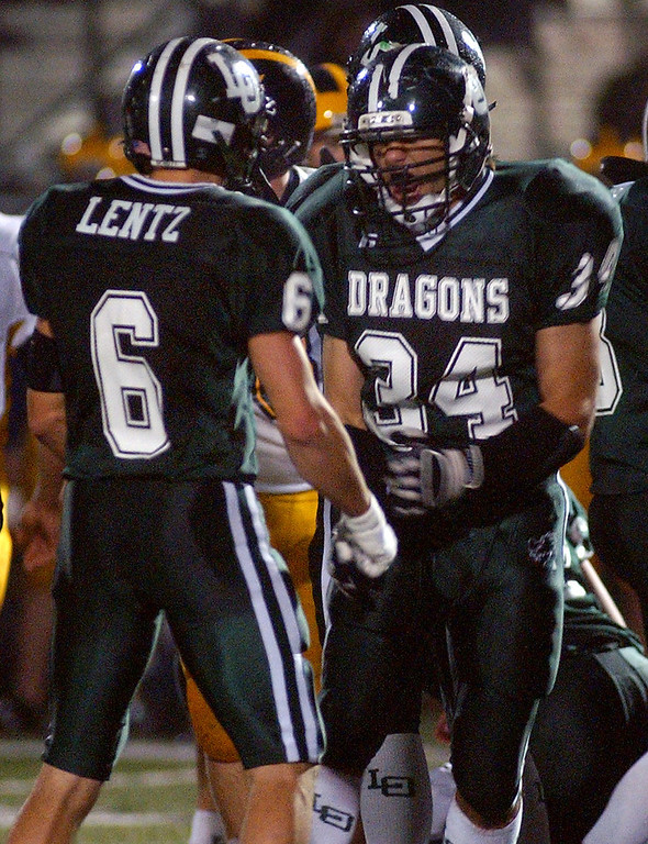 . Lake Orion High School football players Robby Lentz, left, and Evan Gros celebrate a defensive stop against Clarkston during second quarter action, Friday, October 24 2008, at Lake Orion HS in Lake Orion, Mich.  (The Oakland Press/Jose Juarez)