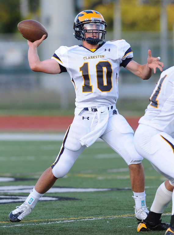 . Clarkston High School football quarterback Tyler Scarlett passes against West Bloomfield during first quarter action.  Photo taken on Thursday, September 17, 2009, in a game played at West Bloomfield HS in West Bloomfield, Mich.  (The Oakland Press/Jose Juarez)