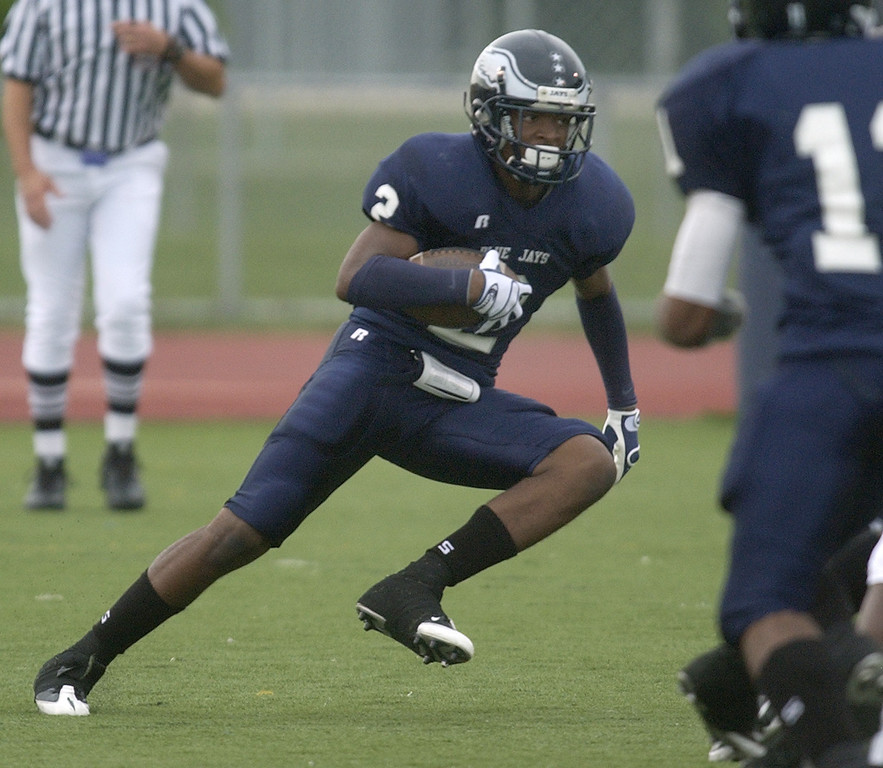 . Southfield High School football player Kevin Harmon returns the opening kickoff against Farmington HS.  Photo taken on Friday, August 27, 2009, in Southfield, Mich.  (The Oakland Press/Jose Juarez)