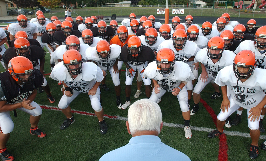 . Birmingham Brother Rice High School football head coach Al Fracassa, foreground, rounds up his team after warmups were completed, and begins practice.  Photo taken on Tuesday, September 15, 2009, at Brother Rice HS in Bloomfield Hills, Mich.  (The Oakland Press/Jose Juarez)