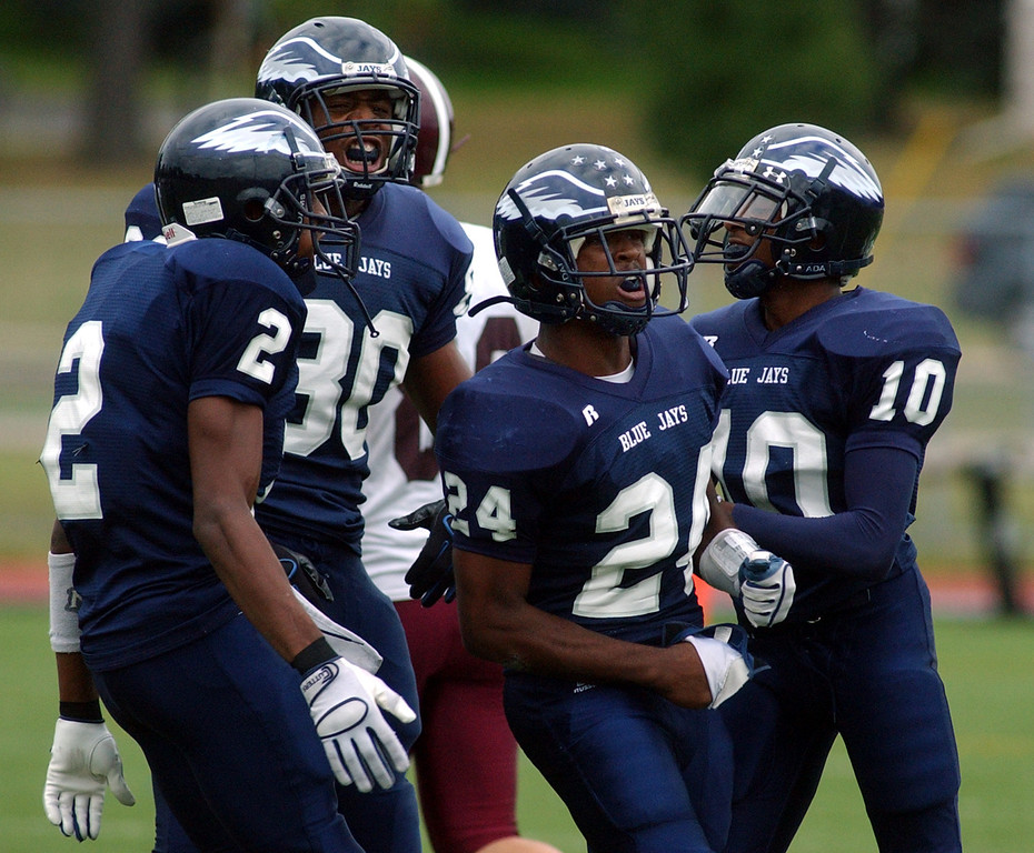 . Southfield High School football defenseman Robert Drayton, second from right, and his teammates react after Drayton made a big hit against Birmingham Seaholm in the first quarter, Friday, September 5, 2008, at Southfield HS in Southfield, Mich.  (The Oakland Press/Jose Juarez)