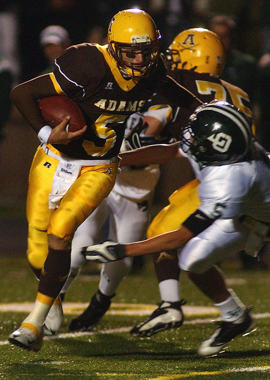 . Rochester Adams High School football quarterback Andrew Wasak runs for yardage as he is tackled by Lake Orion defender Jeff Heath during first quarter action, Friday, October 17, 2008, in a game played at Rochester Adams HS in Rochester Hills, Mich.  (The Oakland Press/Jose Juarez)