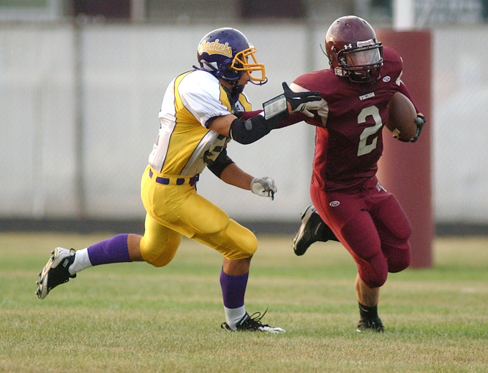 . Hazel Park High School football player Ralph Hopkins, right, returns a kickoff as he is chased by Auburn Hills Avondale player Michael Johnson during first quarter action.  Photo taken on Thursday, September 2, 2010, in a gam played at Hazel Park HS in Hazel Park, Mich.  (The Oakland Press/Jose Juarez)
