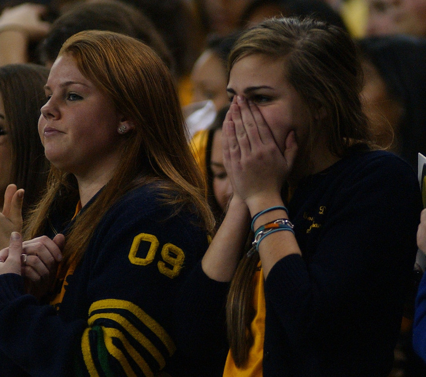 . Birmingham Detroit Country Day High School football fans react after the football team was unable to convert the extra point attempt, after the team\'s first touchdown of the game, during first quarter action, Friday, November 28, 2008, at Ford Field in Detroit, Mich.  (The Oakland Press/Jose Juarez)