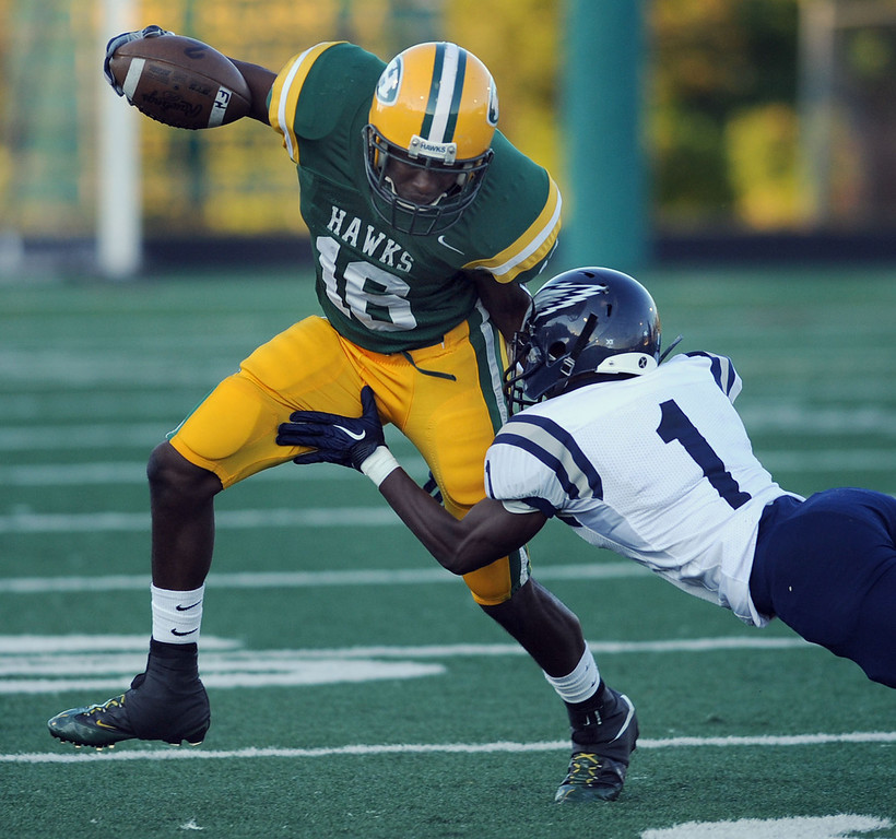 . Farmington Hills Harrison High School football player Aaron Burbridge, left, evades the tackle of Southfield defender Lawrence Hill during second quarter action.  Photo taken on Friday, September 3, 2010, in a game played at Harrison HS in Farmington Hills, Mich.  (The Oakland Press/Jose Juarez)