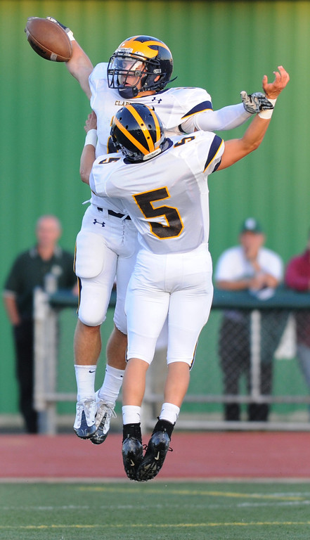 . Clarkston High School football player Dakota Bender, top left, celebrates his touchdown reception with teammate Derek Booker, as they played West Bloomfield during first quarter action.  Photo taken on Thursday, September 17, 2009, in a game played at West Bloomfield HS in West Bloomfield, Mich.  (The Oakland Press/Jose Juarez)