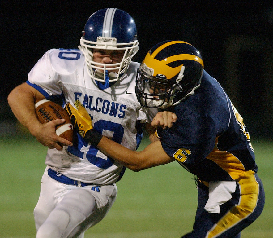 . Rochester High School football player Cody Devoe, left, rushes for yardage as he is tackled by Clarkston defender Ty Foltz, during second quarter action.  Photo taken on Friday, October 1, 2010, in a game played at Clarkston HS in Clarkston, Mich.  (The Oakland Press/Jose Juarez)