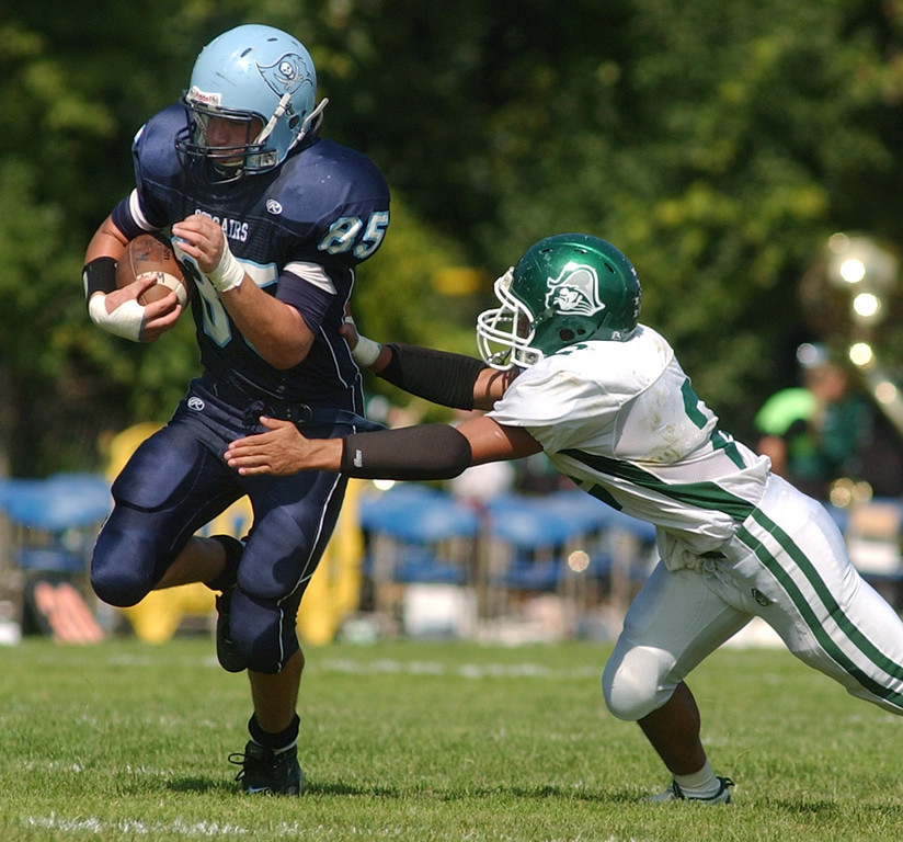 . Waterford Mott High School football player Jacob Wardach, left, runs for yardage as he is chased by an unidentified Waterford Kettering defender during second quarter action, Saturday, September 20, 2008, in a game played at Mott HS in Waterford, Mich.  (The Oakland Press/Jose Juarez)