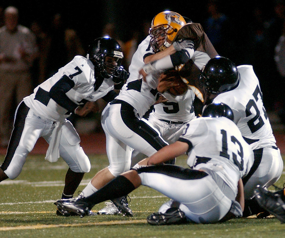 . Several Bloomfield Hills Lahser High School football defenders gang up for a tackle on an unidentified Ferndale player during second quarter action, Friday, October 10, 2008, at Ferndale HS in Ferndale, Mich.  (The Oakland Press/Jose Juarez)