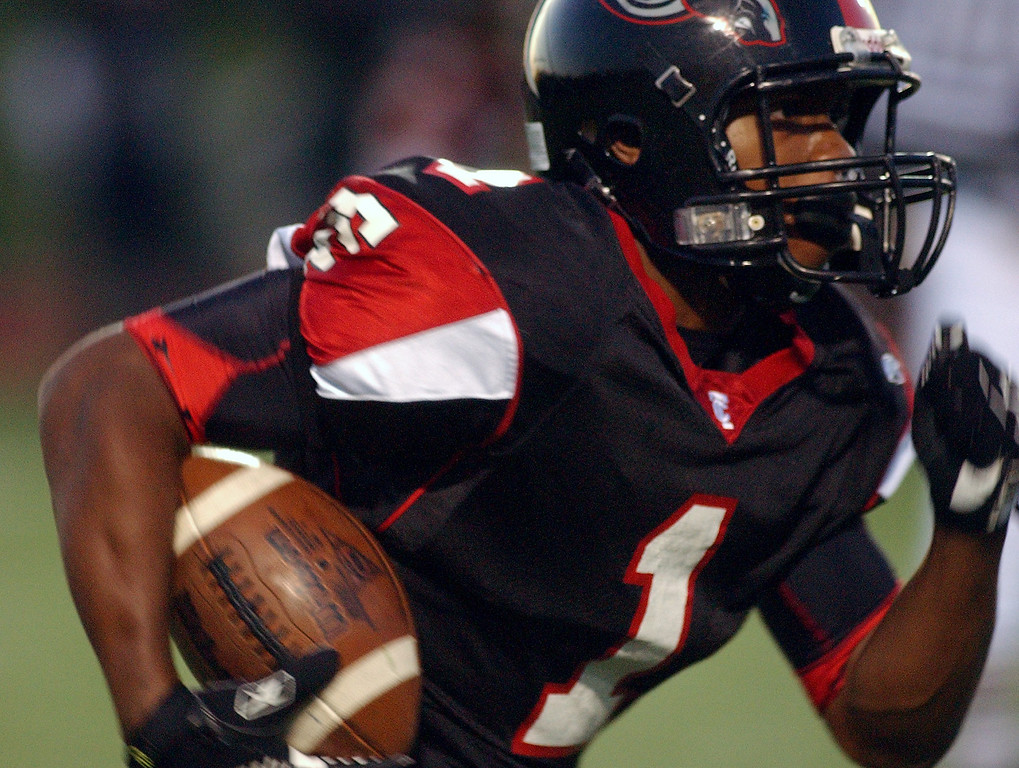 . Troy High School football player Christopher Wheeler runs for yardage against Lake Orion during first quarter action, Friday, October 3, 2008, at Troy HS in Troy, Mich.  (The Oakland Press/Jose Juarez)