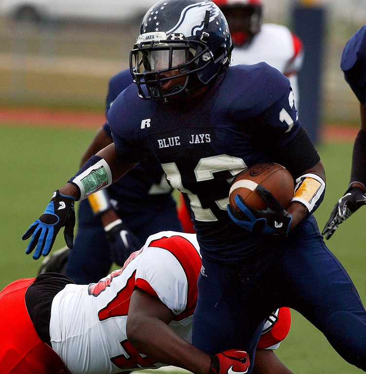 . Southfield High School football player Leviticus Payne, front, runs for yardage as he evades the tackle of an unidentified Oak Park defender, during first quarter action.  Photo taken on Friday, September 10, 2010, in a game played at Southfield HS in Southfield, Mich.  (The Oakland Press/Jose Juarez)