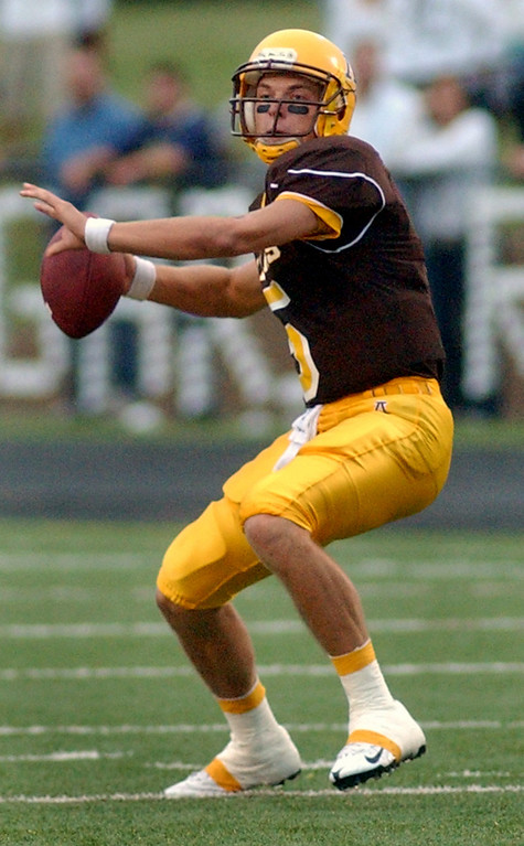 . Rochester Adams High School football quarterback Andrew Waszak drops back to pass against Stoney Creek in the first quarter, Friday, September 5, 2008, in a game played at Adams HS in Rochester Hills, Mich.  (The Oakland Press/Jose Juarez)
