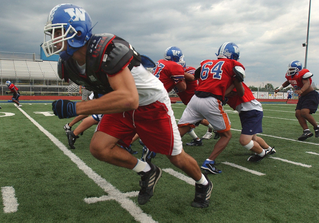 . Walled Lake Western High School football player Edison Vushaj, front, heads up field as he and his teammates work on punt returns during practice, Monday, September 8, 2008, in Walled Lake, Mich.  (The Oakland Press/Jose Juarez)