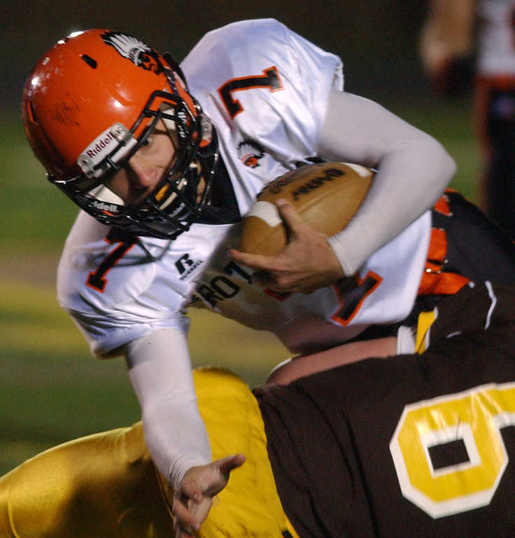 . Birmingham Brother Rice High School football player Frankie Popp, top, dives for yardage as he is tackled by Rochester Adams defender Andrew Hammett, during first quarter action.  Photo taken on Friday, November 6, 2009, in a game played at Rochester Adams HS in Rochester Hills, Mich.  (The Oakland Press/Jose Juarez)