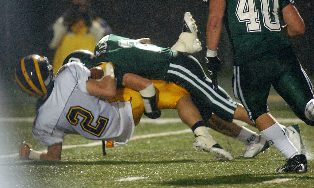 . Lake Orion High School football player Charles Fleck, top, drops Clarkston player Dakota Bender for a loss of yardage in their backfield during second quarter action, Friday, October 24 2008, at Lake Orion HS in Lake Orion, Mich.  (The Oakland Press/Jose Juarez)