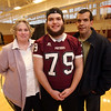 Ayer-Shirley senior football player Dante Sequeira, 18, with his parents Heather and Paul Sequeira. Shane is an MIAA honoree for courage after coming back to football from leg surgeries following a skiing injury.  (SUN Julia Malakie)
