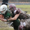 Billerica vs Chelmsford Thanksgiving Day football. Billerica QB Nolan Houlihan (1), is tackled by Chelmsford's Sean Stackpole (10). (SUN/Julia Malakie)