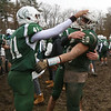 Billerica vs Chelmsford Thanksgiving Day football. Billerica's David Cesar (41) and Ryan Hogan (50) celebrate win over Chelmsford. (SUN/Julia Malakie)