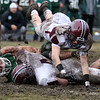Billerica vs Chelmsford Thanksgiving Day football. Chelmsford's William McCarthy (3) dives over teammate Jake Chiasson (4), who'd just tackled Billerica's Colby Cyrus (35). (SUN/Julia Malakie)