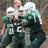 Billerica vs Chelmsford Thanksgiving Day football. Billerica's Dan Cabrera (22) and Ryan Moran (69) celebrate an interception by Cabrera. (SUN/Julia Malakie)