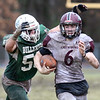 Billerica vs Chelmsford Thanksgiving Day football. Chelmsford QB Mike Lupoli (6) is tackled by Billerica's Ryan Hogan (50). (SUN/Julia Malakie)